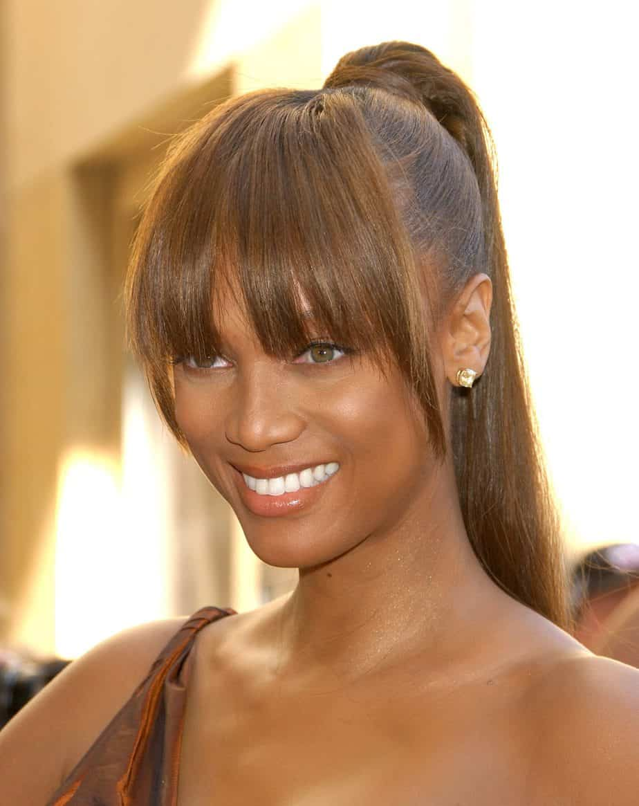 Sleek High Ponytail with Bangs