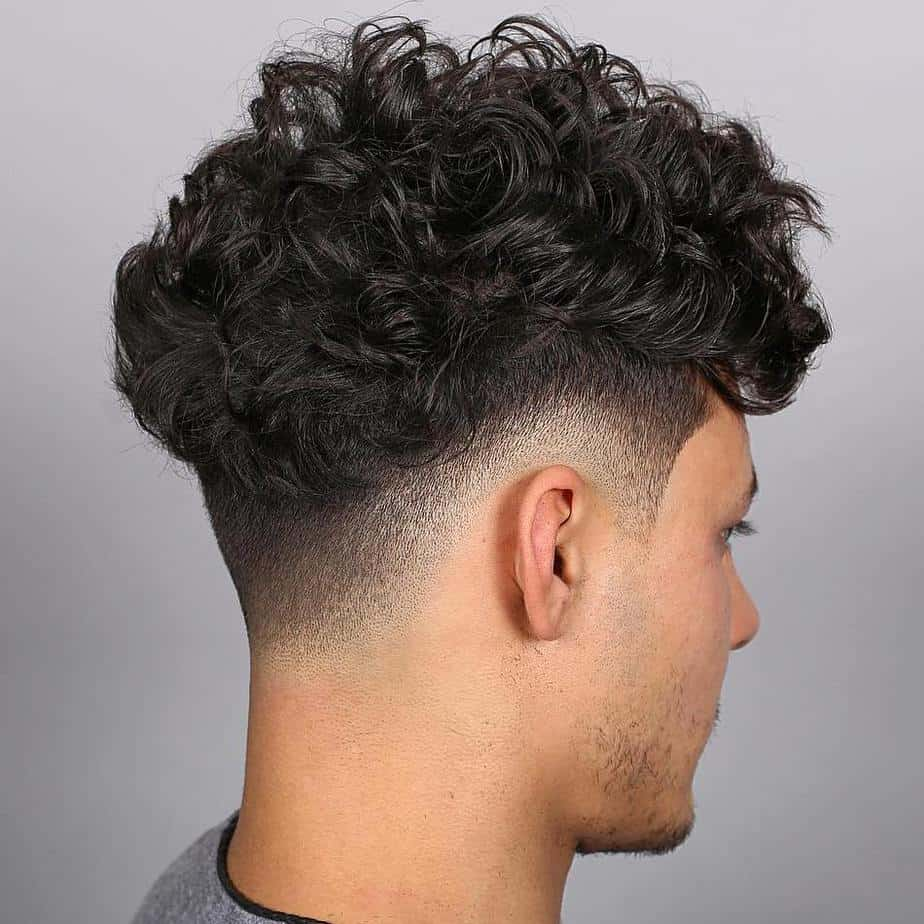 Guys' Haircuts 2021 Curly Fringe with High Fade