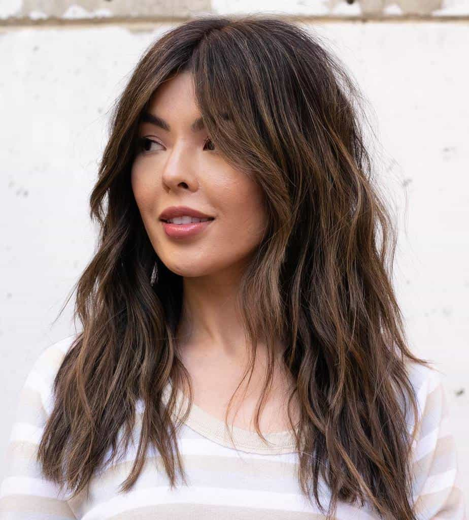 haircuts for long thin hair 2021 layered shag with bangs