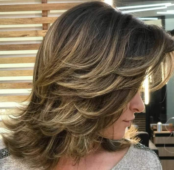 Cascading Medium-Length Hairstyles 2022 with Bangs